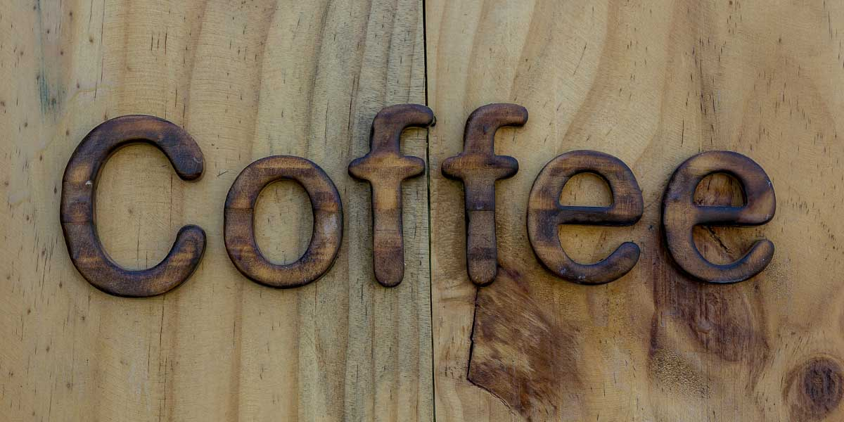 coffee shop logo in wood for retail design