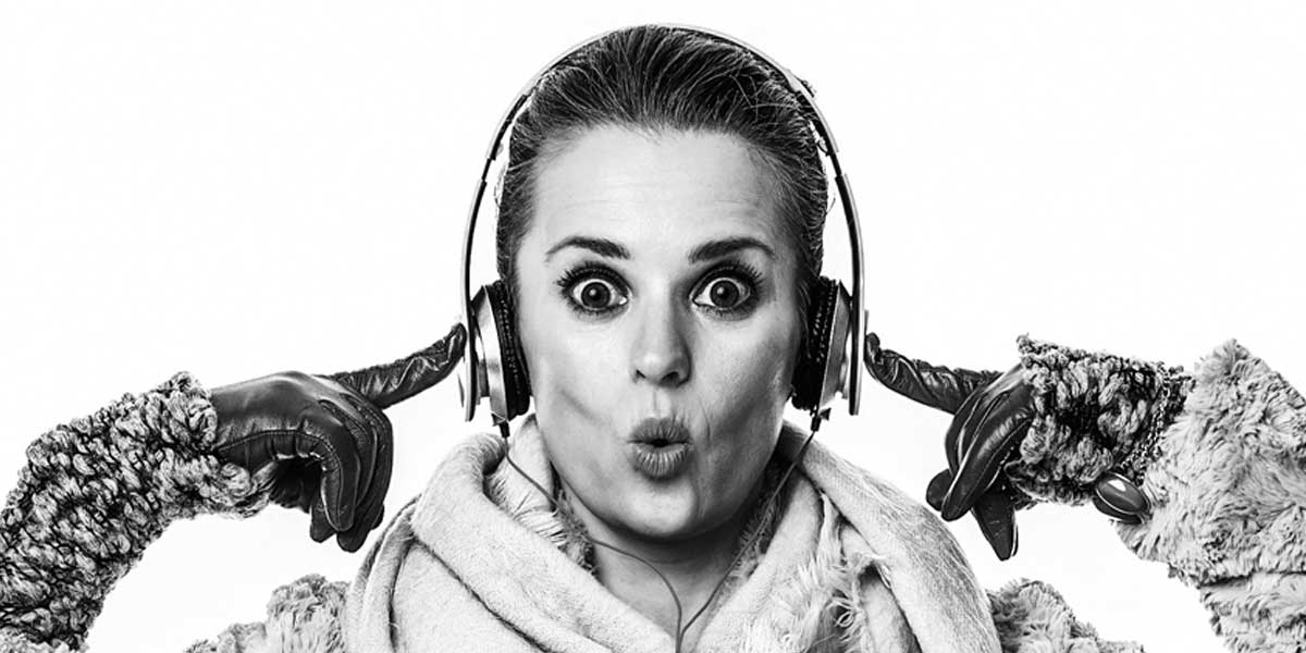 lady with headphones covering her ears for impulse buy